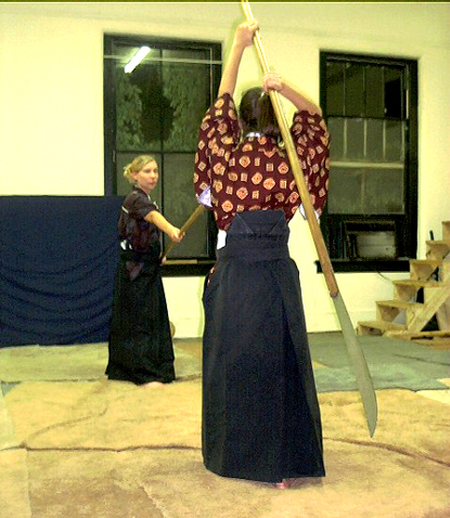 students engaged in naginata sparring