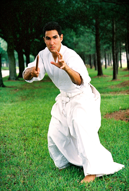 student in traditional tantojutsu fighting pose